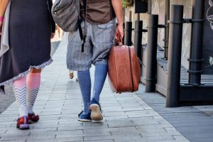 People walking wearing long socks